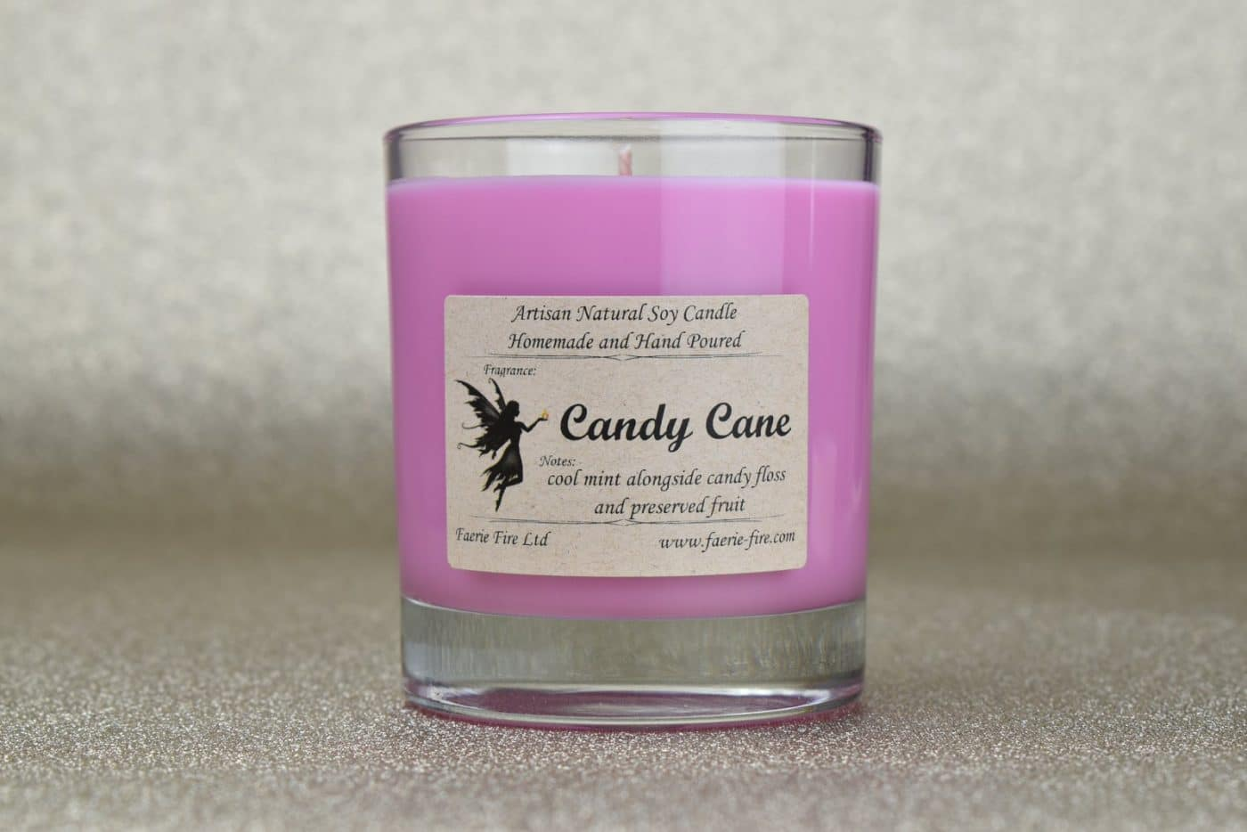 Festive mint candy cane soy way jar candle. Pink in colour against a gold background