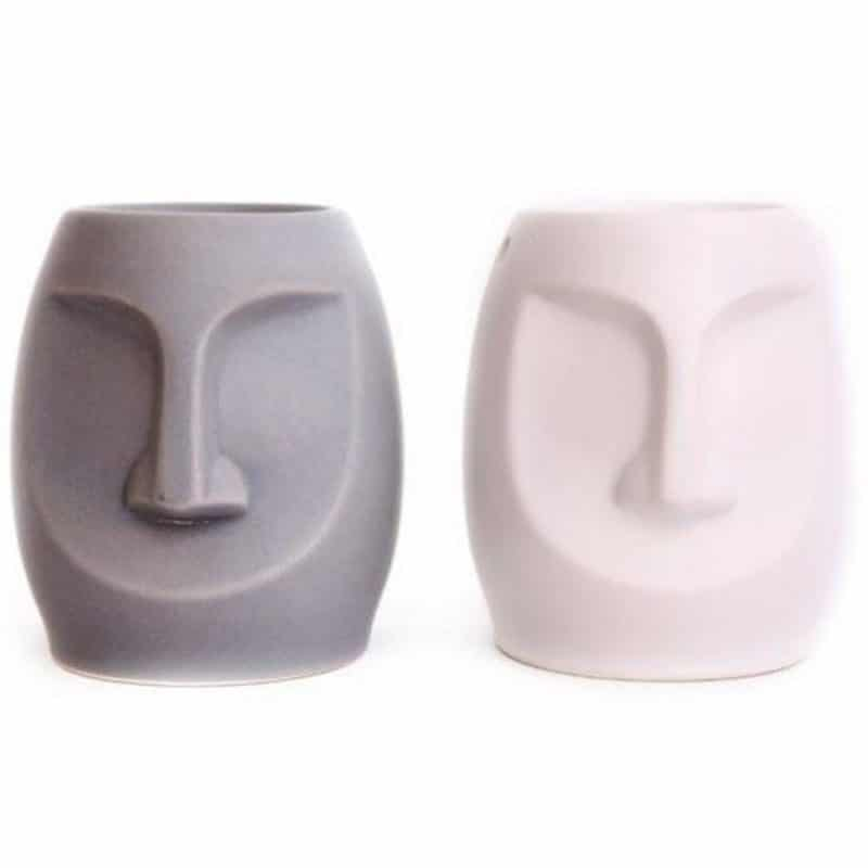 Image of 2 easter island head tealight wax warmers against a white background