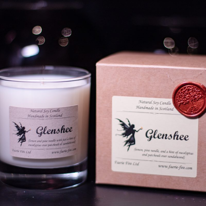 White candle in a clear glass jar with presentation box called Glenshee, smelling like pine and eucalyptus