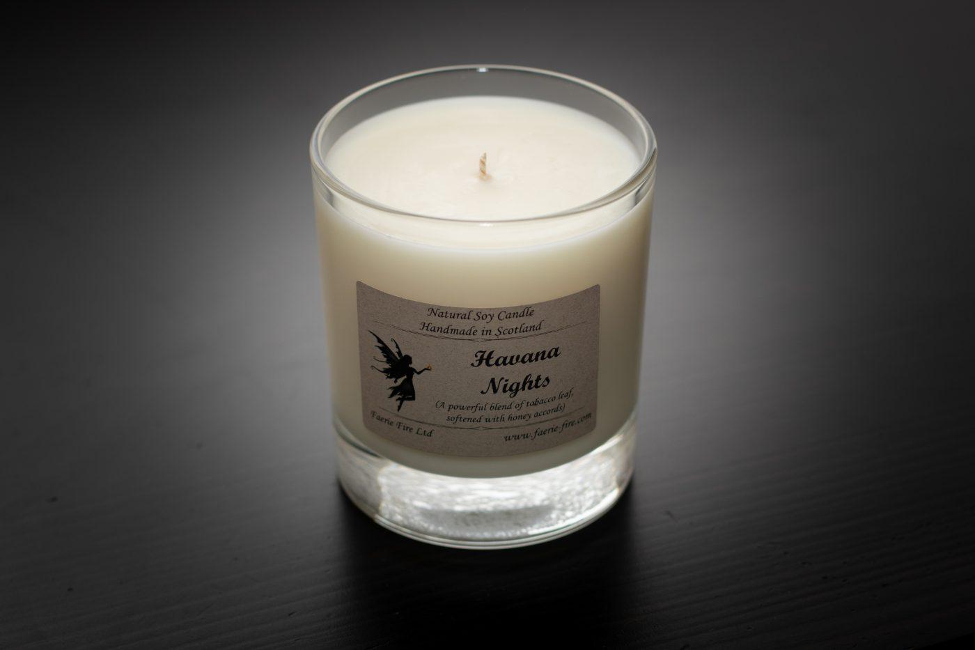 havana nights dark honey and tobacco fragranced white candle in a clear glass jar