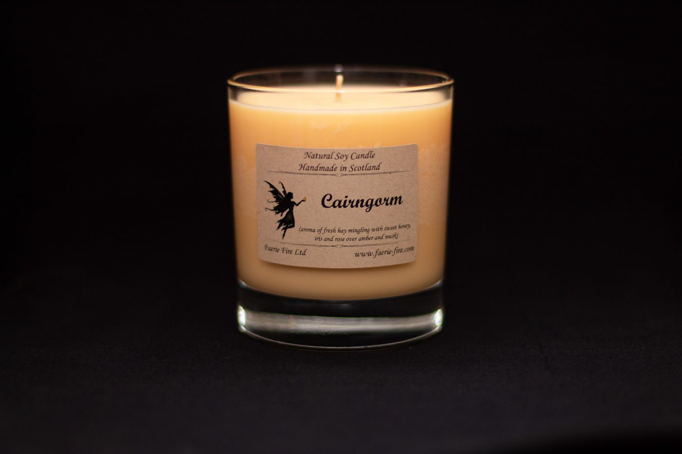Pale dusky yellow Cairngorm Jar Candle smelling like hay, honey and amber in a dark background